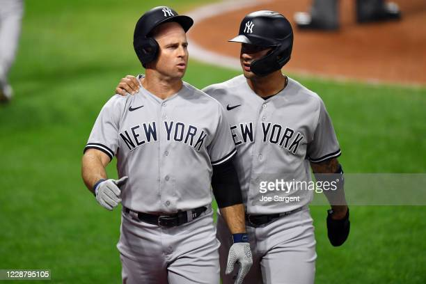 Brett Gardner of the New York Yankees is greeted by teammate Gleyber Torres after hitting a two-run home run in the seventh inning during Game 1 of...