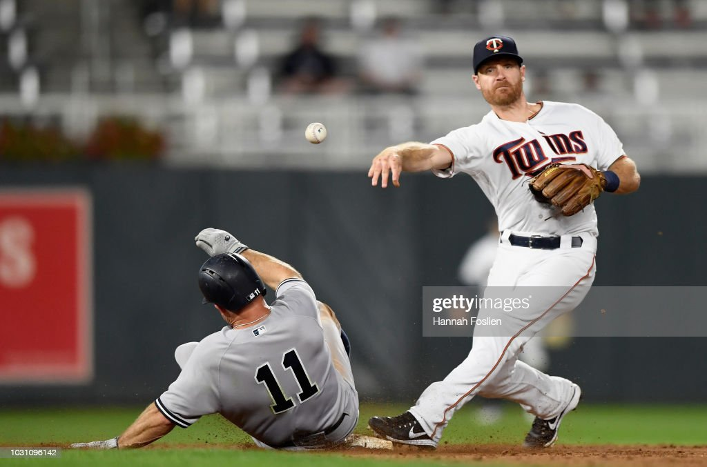 Brett Gardner #11 of the New York Yankees is out at second base as Logan Forsythe #24 of the Minnesota Twins attempts to turn a double play during the ninth inning of the game on September 10, 2018 at Target Field in Minneapolis, Minnesota. The Yankees defeated the Twins 7-2.