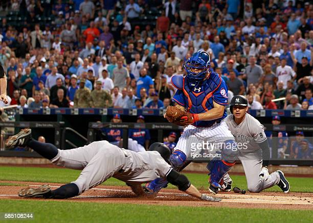 Brett Gardner of the New York Yankees is tagged out by catcher Travis d'Arnaud of the New York Mets after attempting to stretch a triple into an...