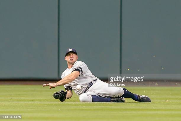 Brett Gardner of the New York Yankees makes a diving attempt on a line drive by Alex Bregman of the Houston Astros in the first inning but unable to...