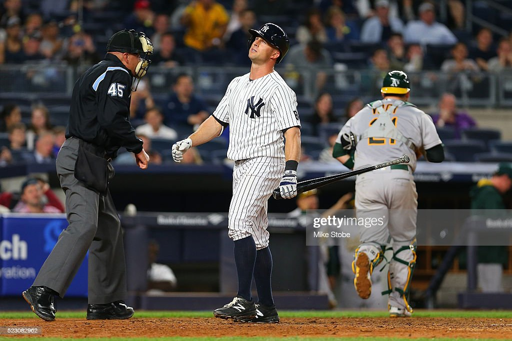Brett Gardner #11 of the New York Yankees reacts after being called out on strikes to end the eighth inning against the Oakland Athletics at Yankee Stadium on April 21, 2016 in the Bronx borough of New York City.