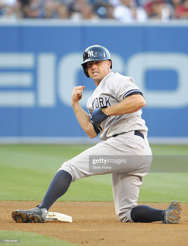 Brett Gardner #11 of the New York Yankees reacts after stealing second base during the sixth inning of a baseball game against the San Diego Padres at Petco Park on August 3, 2013 in San Diego, California.