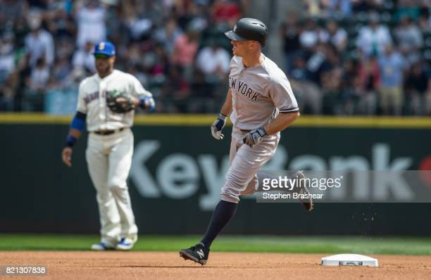 Brett Gardner of the New York Yankees rounds the bases after hitting a solo home run off of starting pitcher Yovani Gallardo of the Seattle Mariners...