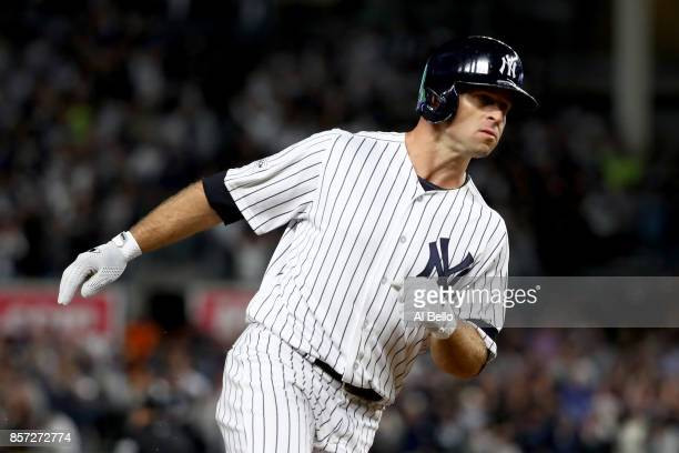 Brett Gardner of the New York Yankees rounds the bases after hitting a home run against Ervin Santana of the Minnesota Twins during the second inning...