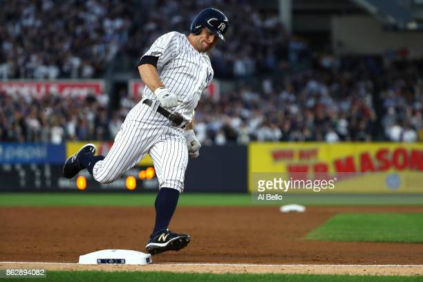 Brett Gardner of the New York Yankees rounds third base on his way to score on a double by Aaron Judge during the third inning against the Houston...