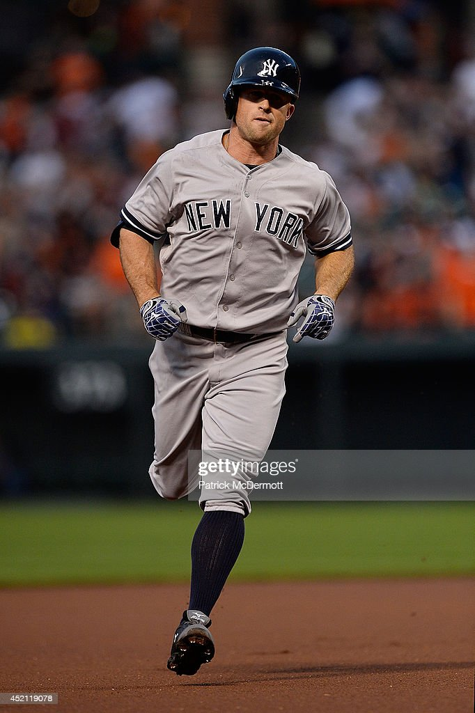 Brett Gardner #11 of the New York Yankees runs the bases after hitting a solo home run in the first inning during a game against the Baltimore Orioles at Oriole Park at Camden Yards on July 13, 2014 in Baltimore, Maryland.