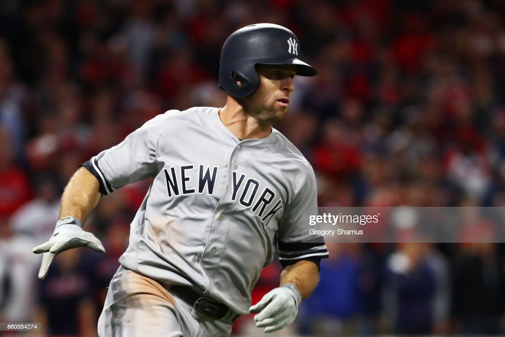 Brett Gardner #11 of the New York Yankees runs to first after hitting a two RBI single in the ninth inning against the Cleveland Indians in Game Five of the American League Divisional Series at Progressive Field on October 11, 2017 in Cleveland, Ohio.