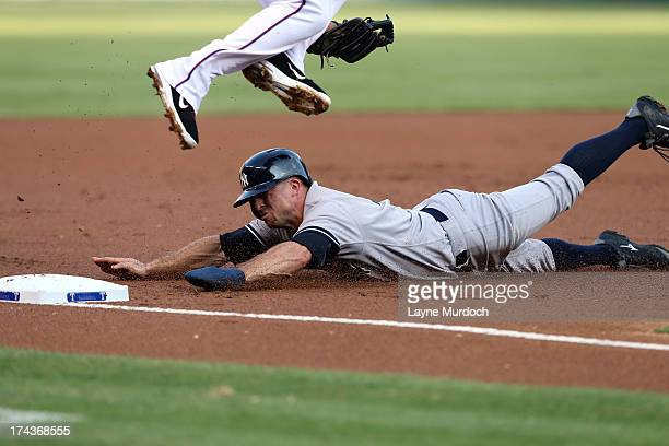 Brett Gardner of the New York Yankees slides safely into 3rd base under Adrian Beltre of the Texas Rangers on July 24 2013 at the Rangers Ballpark in...