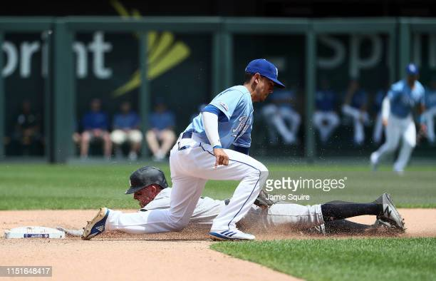 Brett Gardner of the New York Yankees slides safely into second base for a steal as Nicky Lopez of the Kansas City Royals is late applying the tag...
