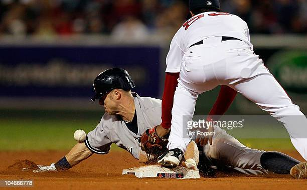 Brett Gardner of the New York Yankees steals second base against the Boston Red Sox in the second game of a doubleheader at Fenway Park October 2 in...