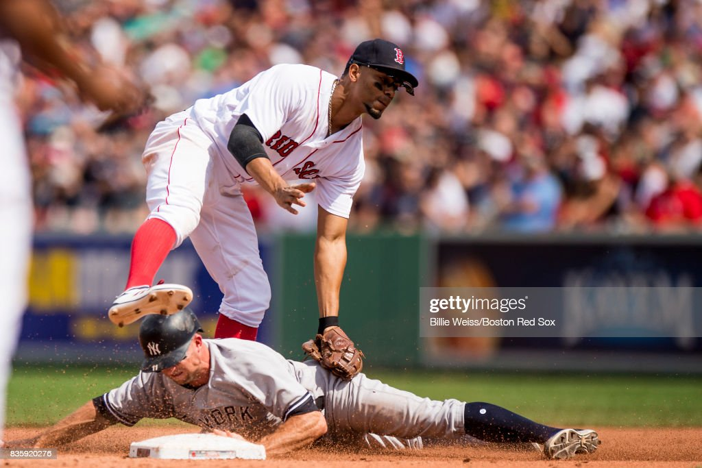 Brett Gardner #11 of the New York Yankees steals second base as he evades the tag of Xander Bogaerts #2 of the Boston Red Sox during the fourth inning of a game on August 20, 2017 at Fenway Park in Boston, Massachusetts.