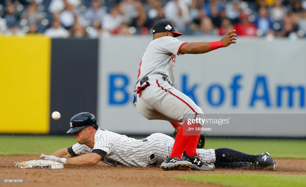 Brett Gardner #11 of the New York Yankees steals second base during the first inning and advances to third base as the ball gets past Wilmer Difo #1 of the Washington Nationals at Yankee Stadium on June 13, 2018 in the Bronx borough of New York City.