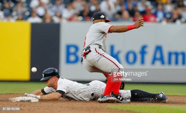 Brett Gardner of the New York Yankees steals second base during the first inning and advances to third base as the ball gets past Wilmer Difo of the...