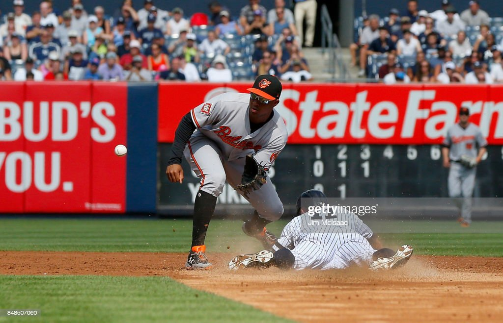 Brett Gardner #11 of the New York Yankees steals second base in the third inning ahead of the throw to Jonathan Schoop #6 of the Baltimore Orioles at Yankee Stadium on September 17, 2017 in the Bronx borough of New York City.