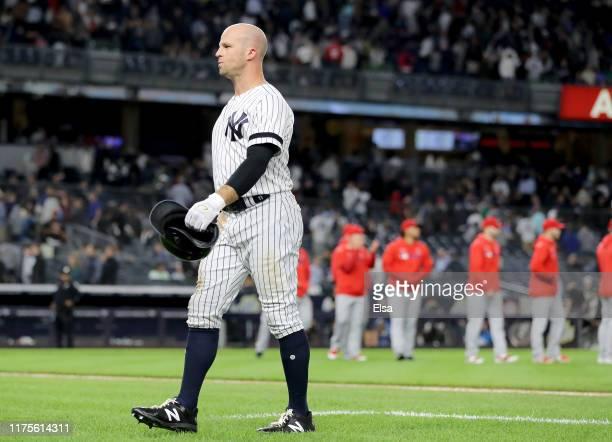 Brett Gardner of the New York Yankees walks off the field as the Los Angeles Angels celebrate the 32 win over the New York Yankees at Yankee Stadium...