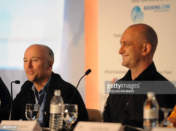 Brett Godfrey chief executive officer of Virgin Blue talks while Bruce Buchanan , chief executive officer of Jetstar smile at a press conference...