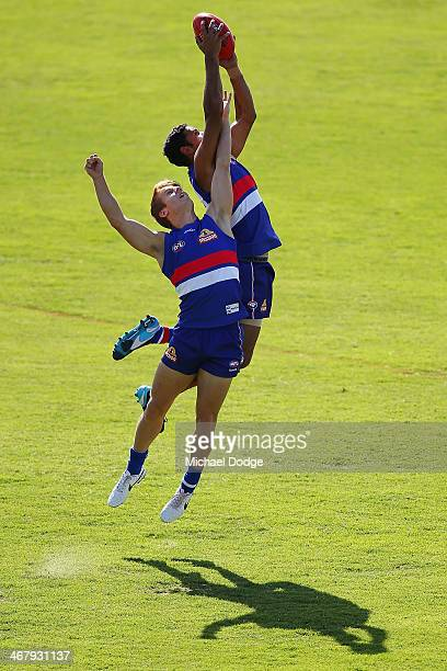 Brett Goodes marks the ball against Lachie Hunter during a Western Bullldogs AFL training session at Victoria University Whitten Oval on February 9,...