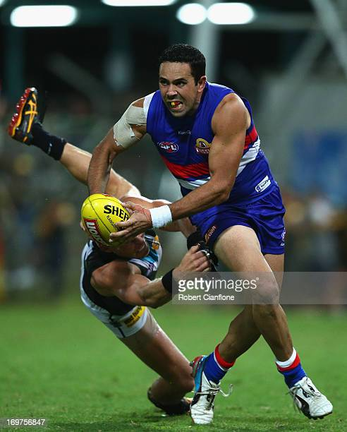Brett Goodes of the Bulldogs is challenged by Brad Ebert of the Power during the round ten AFL match between the Western Bulldogs and Port Adelaide...