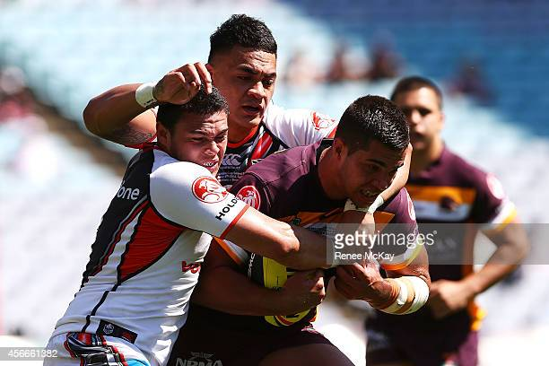 Brett Greinke of the Broncos is tackled during the 2014 Under 20's Holden Cup Grand Final match between the Brisbane Broncos and the New Zealand...