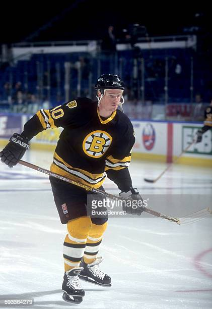 Brett Harkins of the Boston Bruins skates on the ice during warm-ups before an NHL game against the New York Islanders on April 24, 1995 at the...