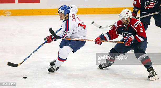 Brett Hauer of the USA tangles with Miroslav Satan of Slovakia in the teams' bronze medal match at the International Ice Hockey Federation World...