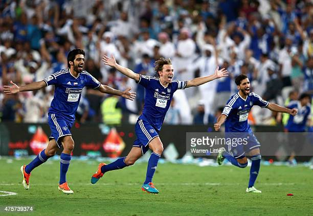Brett Holman, Al Nasr Captain leads the celebrations after winning the penalty shoot out to win the President's Cup Final between Al Ahli and Al Nasr...