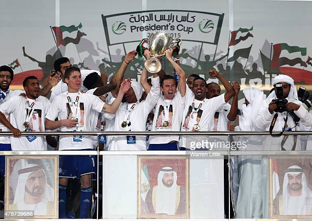 Brett Holman, Captain of Al Nasr team leads celebrations winning the President's Cup Final after a penalty shoot out between Al Ahli and Al Nasr at...