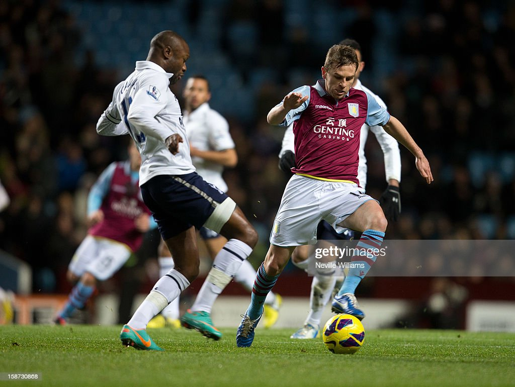 Brett Holman of Aston Villa challenged by WIlliam Gallas of Tottenham Hotspur during the Barclays Premier League match between Aston Villa and Tottenham Hotspur at Villa Park on December 26, 2012 in Birmingham, England.
