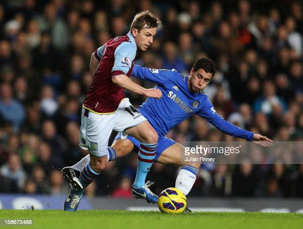 Brett Holman of Aston Villa holds off Eden Hazard of Chelsea during the Barclays Premier League match between Chelsea and Aston Villa at Stamford...