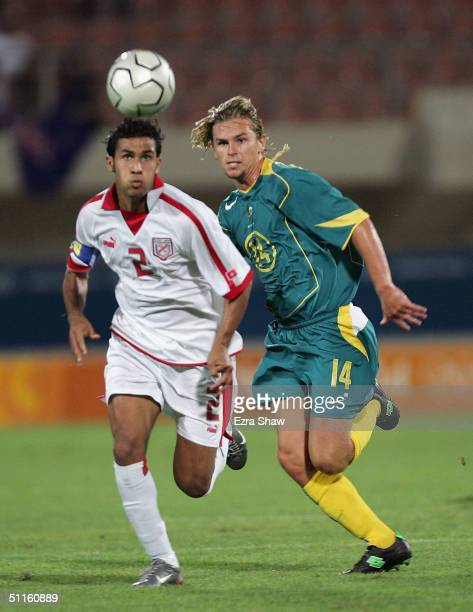Brett Holman of Australia and Anis Boussaidi of Tunisia go for the ball during the men's football preliminary match on August 11 2004 during the...