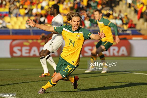 Brett Holman of Australia celebrates after scoring the opening goal during the 2010 FIFA World Cup South Africa Group D match between Ghana and...