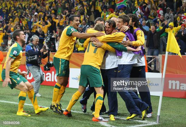 Brett Holman of Australia celebrates with team mates after scoring his side's second goal during the 2010 FIFA World Cup South Africa Group D match...