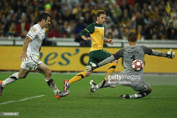 Brett Holman of Australia gets the ball past New Zealand goalkeeper Mark Paston to score during the 2010 FIFA World Cup PreTournament match between...