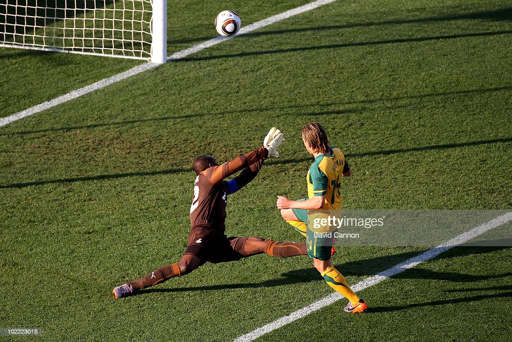 Brett Holman of Australia lifts the ball over Richard Kingson of Ghana and scores the opening goal during the 2010 FIFA World Cup South Africa Group D match between Ghana and Australia at the Royal Bafokeng Stadium on June 19, 2010 in Rustenburg, South Africa.