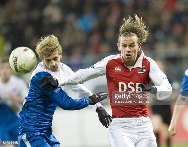 Brett Holman of AZ Alkmaar duels with FC Utrecht's Mihal Nesu during their Dutch first league match in Alkmaar on December 19 2008 AFP...