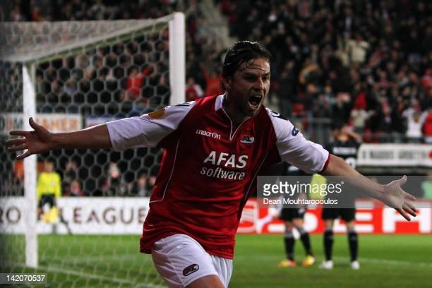 Brett Holman of AZ celebrates scoring the first goal of the game during the UEFA Europa League quarter final first leg match between AZ Alkmaar and...