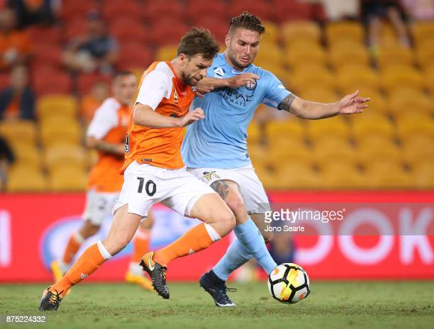 Brett Holman of Brisbane and Bart Schenkeveld of Melbourne during the round seven ALeague match between Brisbane Roar and Melbourne City at Suncorp...