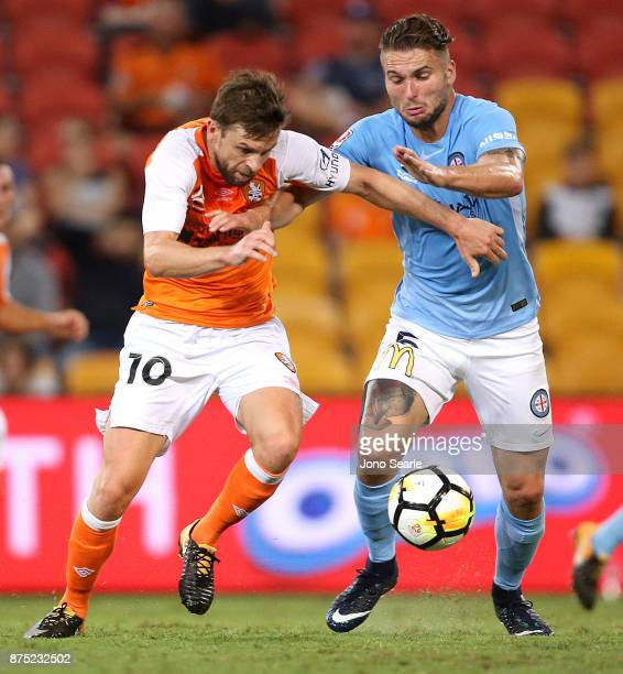 Brett Holman of Brisbane and Bart Schenkeveld of Melbourne fight for the ball during the round seven ALeague match between Brisbane Roar and...