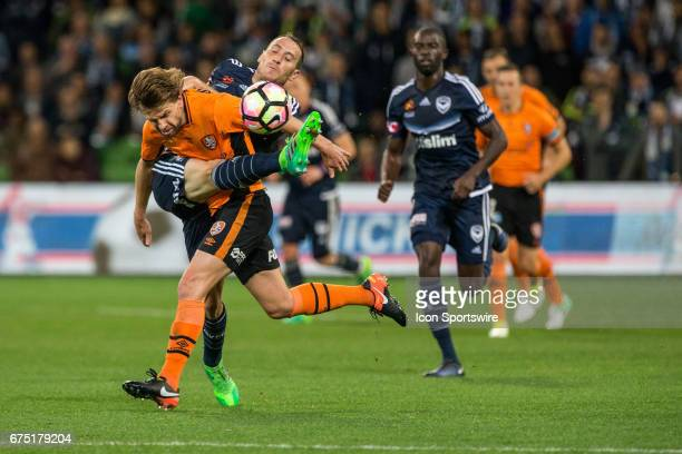 Brett Holman of the Brisbane Roar and Alan Baro of Melbourne Victory contest the ball during the Semi Final Match of the Hyundai ALeague Finals...