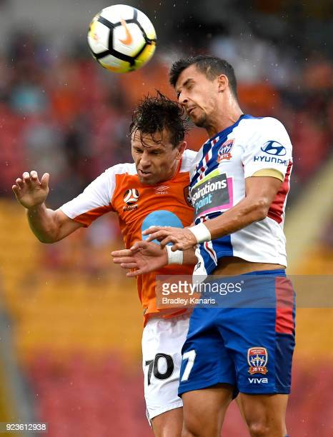 Brett Holman of the Roar and Daniel Georgievski of the Jets challenge for the ball during the round 21 ALeague match between the Brisbane Roar and...