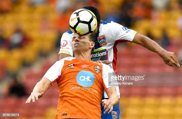 Brett Holman of the Roar and Nikolai ToporStanley of the Jets challenge for the ball during the round 21 ALeague match between the Brisbane Roar and...