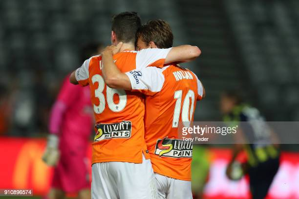 Brett Holman of the Roar celebrates a goal with team mate Daniel Leck during the round 18 ALeague match between the Central Coast Mariners and the...