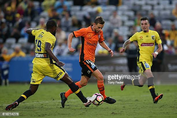 Brett Holman of the Roar contests the ball with Jacques Faty of the Mariners during the round three ALeague match between the Central Coast Mariners...