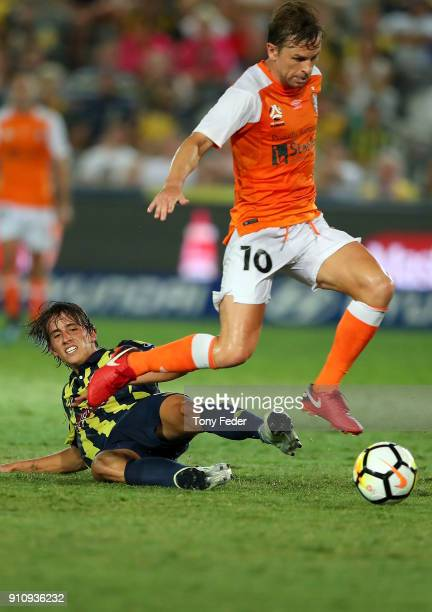 Brett Holman of the Roar contests the ball with Lachlan Wales of the Mariners during the round 18 ALeague match between the Central Coast Mariners...