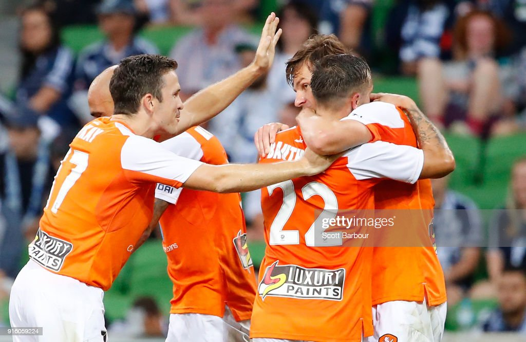 Brett Holman of the Roar is congratulated by his teammates after scoring the Roars second goal as Victory goalkeeper Lawrence Thomas looks on during the round 20 A-League match between the Melbourne Victory and the Brisbane Roar at AAMI Park on February 9, 2018 in Melbourne, Australia.