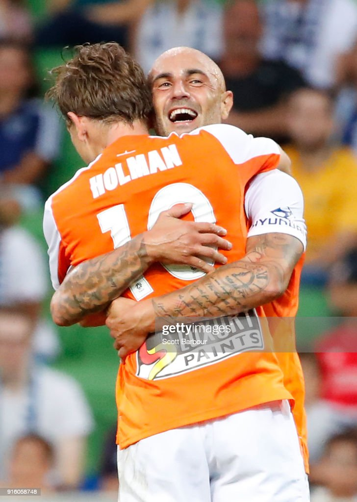 Brett Holman of the Roar is congratulated by Massimo Maccarone after scoring the Roars second goal during the round 20 A-League match between the Melbourne Victory and the Brisbane Roar at AAMI Park on February 9, 2018 in Melbourne, Australia.