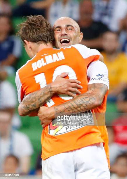 Brett Holman of the Roar is congratulated by Massimo Maccarone after scoring the Roars second goal during the round 20 ALeague match between the...