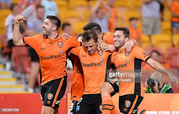 Brett Holman of the Roar is congratulated by team mates after scoring a goal during the round 17 ALeague match between the Brisbane Roar and the...