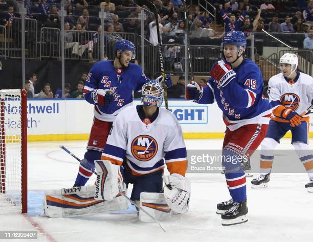 Brett Howden and Kaapo Kakko of the New York Rangers celebrate a second period goal by Vitali Kravtsov against Thomas Greiss of the New York...