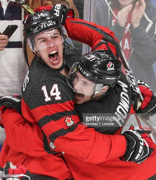 Brett Howden and Maxime Comtois of Canada celebrate a Canada goal by Comtois that gave Canada a 31 lead during the second period of play in the IIHF...